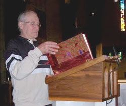 Lector at the ambo in St. Charles Borromeo Church